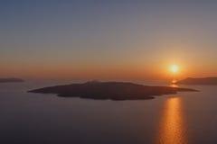 Sunset behind caldera of Santorini Stock Image
