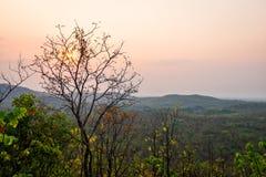 Sunset behind cloud at horizon of sky and mountain Stock Photography