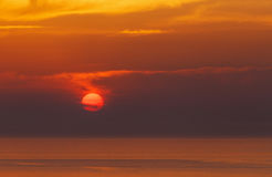 Sunset behind clouds in Oia Stock Image
