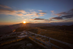 Sunset behind Col Vsentin Peak, Cansiglio forest. Veneto, Italy Royalty Free Stock Photography