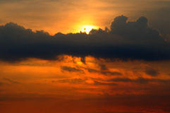Sunset behind dark clouds Royalty Free Stock Photo