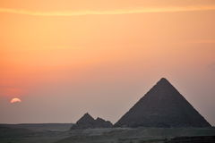 Sunset behind distant Egyptian pyramids Royalty Free Stock Images