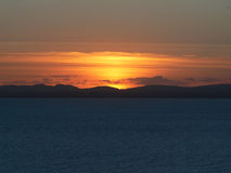 Sunset behind the distant mountains Stock Images