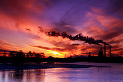 Sunset behind factory Royalty Free Stock Photos