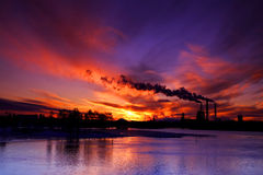 Sunset behind factory Stock Images