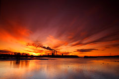 Sunset behind factory Stock Photography