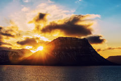 Sunset behind the famous mountain Kirkjufell Royalty Free Stock Images