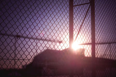 Sunset Behind Fence Stock Photos