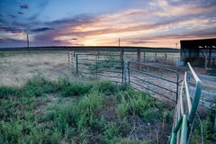 Sunset behind fencing in Eastern Plains Colorado Royalty Free Stock Photos