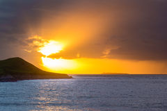 Sunset behind Flat Holm Island in the Bristol Channel Royalty Free Stock Image