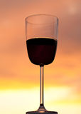 Sunset behind glass of red wine Stock Photography