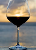 Sunset Behind a Glass of Red Wine Stock Photography