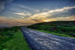 Road with bend to sunset. stock photo