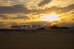 Sunset Behind Homes at Virginia Beach, Virginia. Homes on the beach during sunser Stock Images