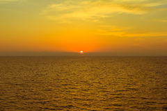 Sunset behind island at mediterranean sea Stock Images