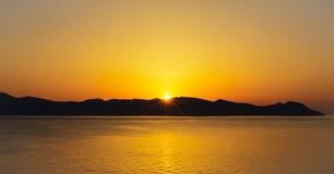 Sunset behind island at mediterranean sea Stock Photography
