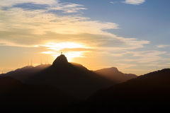 Sunset behind Mountain Corcovado Christ the Redeemer, Rio de Jan Royalty Free Stock Image