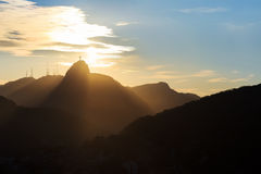Sunset behind Mountain Corcovado Christ the Redeemer, Rio de Jan Stock Photo