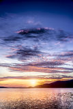 Sunset behind the mountain. Stock Photos