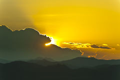 Sunset behind mountains Royalty Free Stock Photography