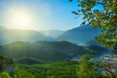 Sunset behind mountains Royalty Free Stock Photos