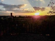 Sunset behind the mountains Stock Photos