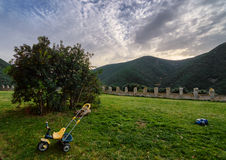 Sunset behind the mountains from a garden. With an abandoned child toys Stock Photo
