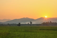 Sunset behind mountains Stock Photography