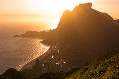 Sunset Behind Mountains in Rio de Janeiro. Sunset in Sao Conrado Beach in Rio de Janeiro, Surrounded by Mountains, the Sun is Going Down Behind the Pedra da Stock Photography