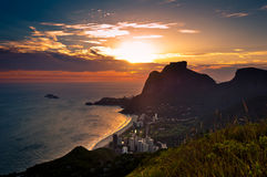 Sunset Behind Mountains in Rio de Janeiro. Sunset in Sao Conrado Beach in Rio de Janeiro, Surrounded by Mountains, the Sun is Going Down Behind the Pedra da Stock Photo