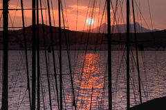 Sunset. Behind the mountains seen from some sailing boats Royalty Free Stock Photos