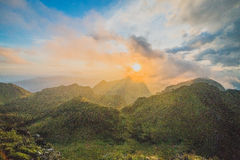 Sunset behind mountains Royalty Free Stock Photo