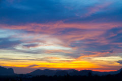 Sunset behind the Mountains and twilight light in the sky Stock Photography
