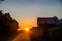 Sunset behind old barn Royalty Free Stock Photo