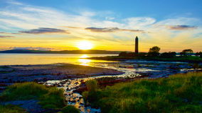 Sunset behind the Pencil monument in Largs. Stock Image