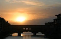 Sunset Behind Ponte Vecchio Bridge Florence Italy. Sunset at the Ponte Vecchio Bridge in Florence, Italy Royalty Free Stock Photos