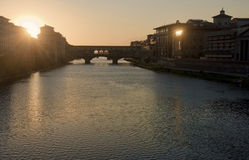 Sunset behind Ponte Vecchio bridge in Florence Stock Photos