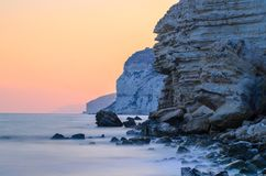 Sunset Behind Rock Cliffs Royalty Free Stock Photography