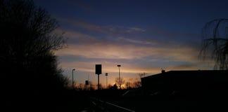 Sunset behind school stock photo