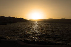 Sunset behind sea on the horizon at Malta, St. Paul Stock Images