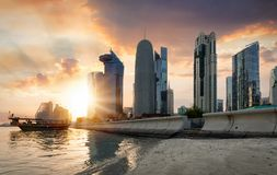 Sunset behind the skyscrapers of Doha Royalty Free Stock Photos