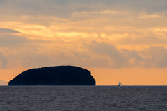 Sunset behind Steep Holm Island in the Bristol Channel, with yac Stock Photos