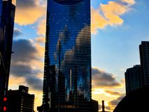 Sunset behind a tower along the Chicago River as seen from the Riverwalk during winter. Sunset behind a tower near Wolf Point at the Chicago River Royalty Free Stock Images