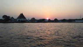 Sunset behind Wat Kalayanamit Woramahavihara Temple across Chao Phraya River in Bangkok, Thailand. Royalty Free Stock Photography