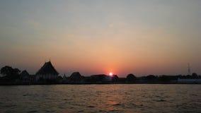 Sunset behind Wat Kalayanamit Woramahavihara Temple across Chao Phraya River in Bangkok, Thailand. Royalty Free Stock Photos