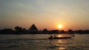 Sunset behind Wat Kalayanamit Woramahavihara Temple across Chao Phraya River in Bangkok, Thailand. Royalty Free Stock Images