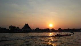 Sunset behind Wat Kalayanamit Woramahavihara Temple across Chao Phraya River in Bangkok, Thailand. Sunset behind Wat Kalayanamit Woramahavihara Wat Kalaya Royalty Free Stock Images