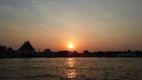 Sunset behind Wat Kalayanamit Woramahavihara Temple across Chao Phraya River in Bangkok, Thailand. Stock Images