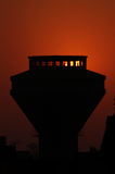 Sunset in cairo in egypt in africa. Sunset behind water tank of a city in egypt in africa Royalty Free Stock Image