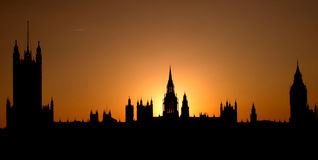 Sunset behind Westminster peaks, London, England. A postcard with The Westminster (British Parliament) and the sun setting behind its peaks Royalty Free Stock Photography